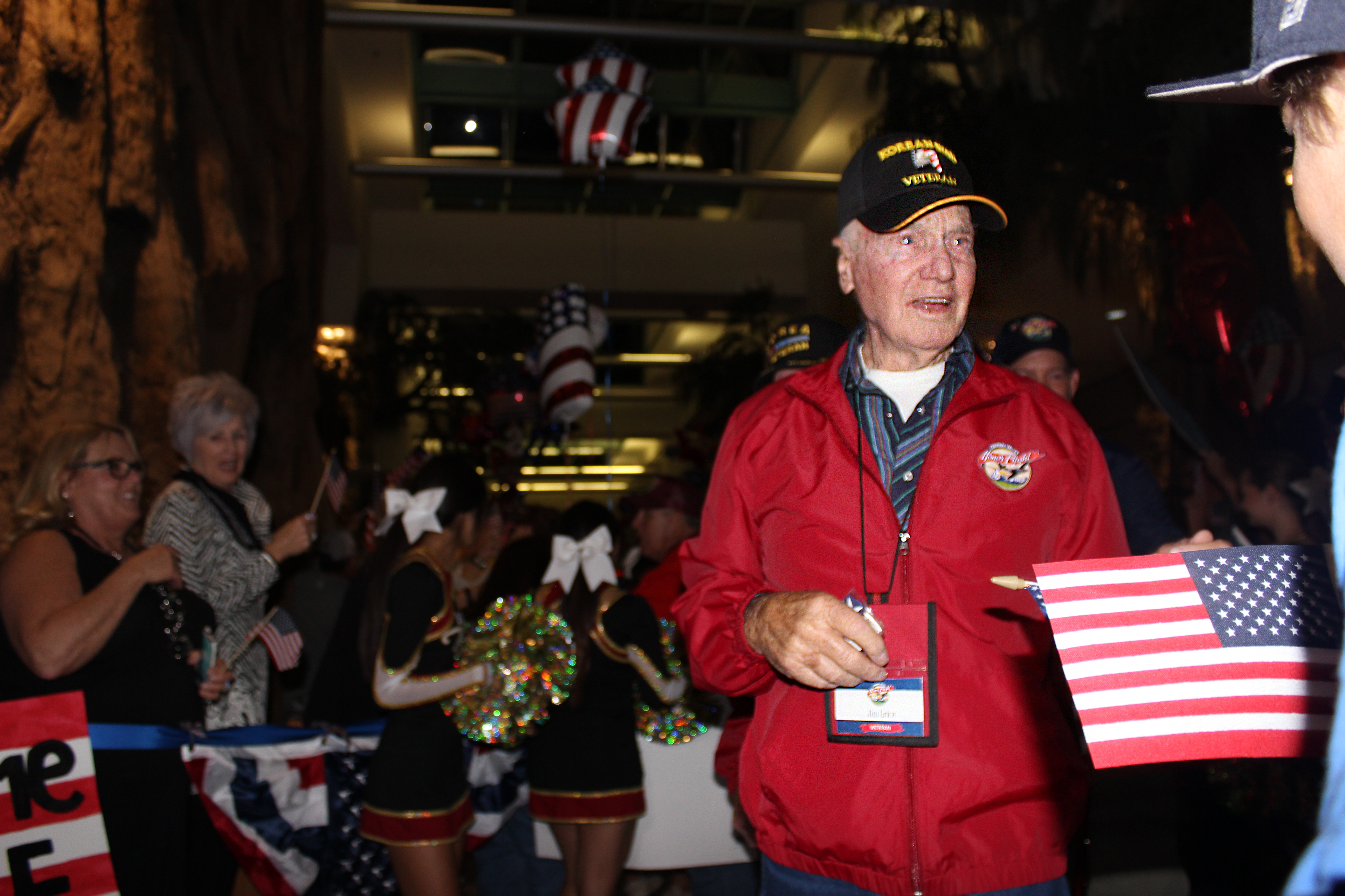 Jim exiting the Honor Flight at the Fresno Airport homecoming.