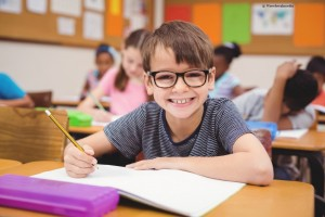 little-boy-working-at-his-desk-in-class-picture-id486555568